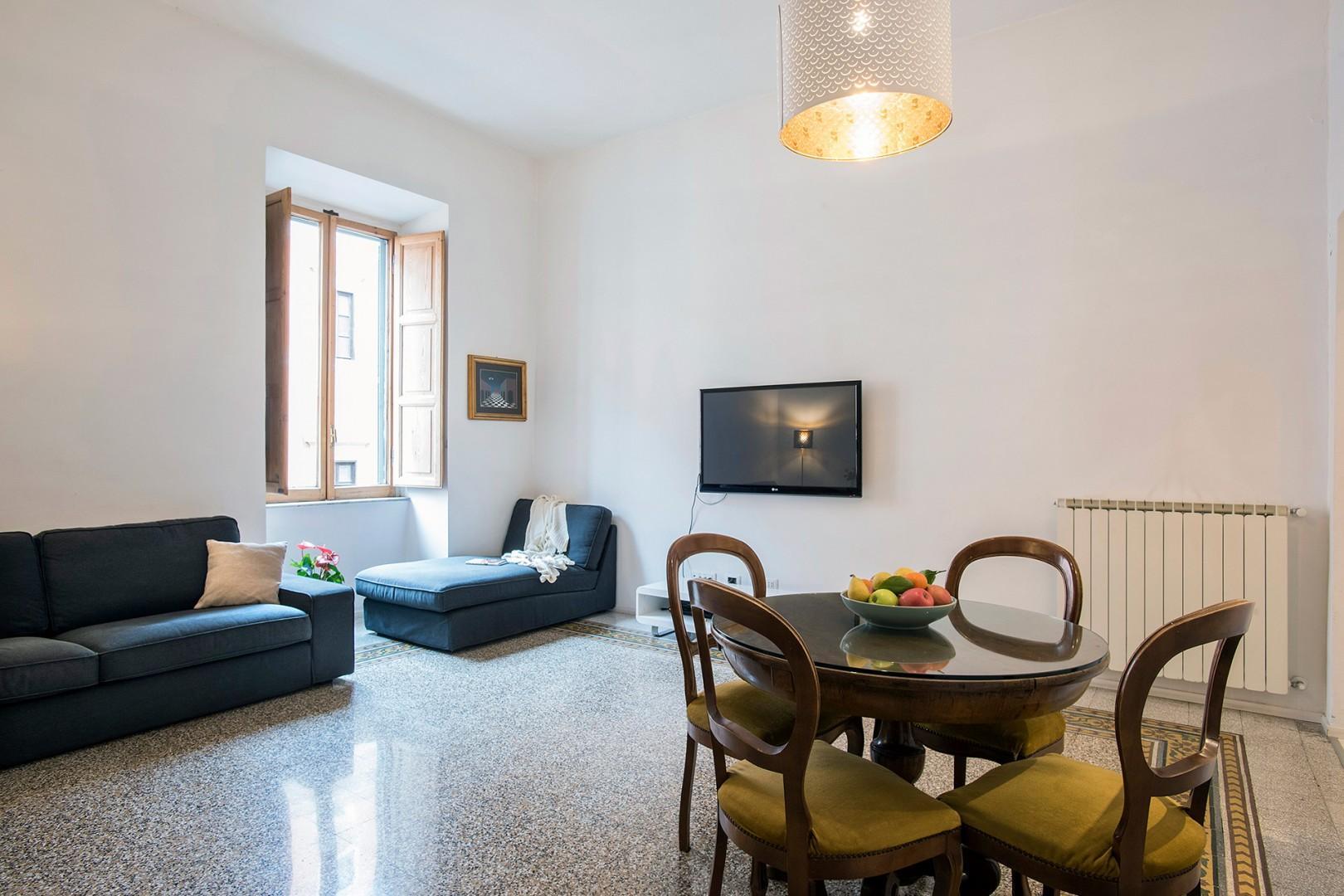 Bright living room of the Verdi apartment overlooks a quiet street.