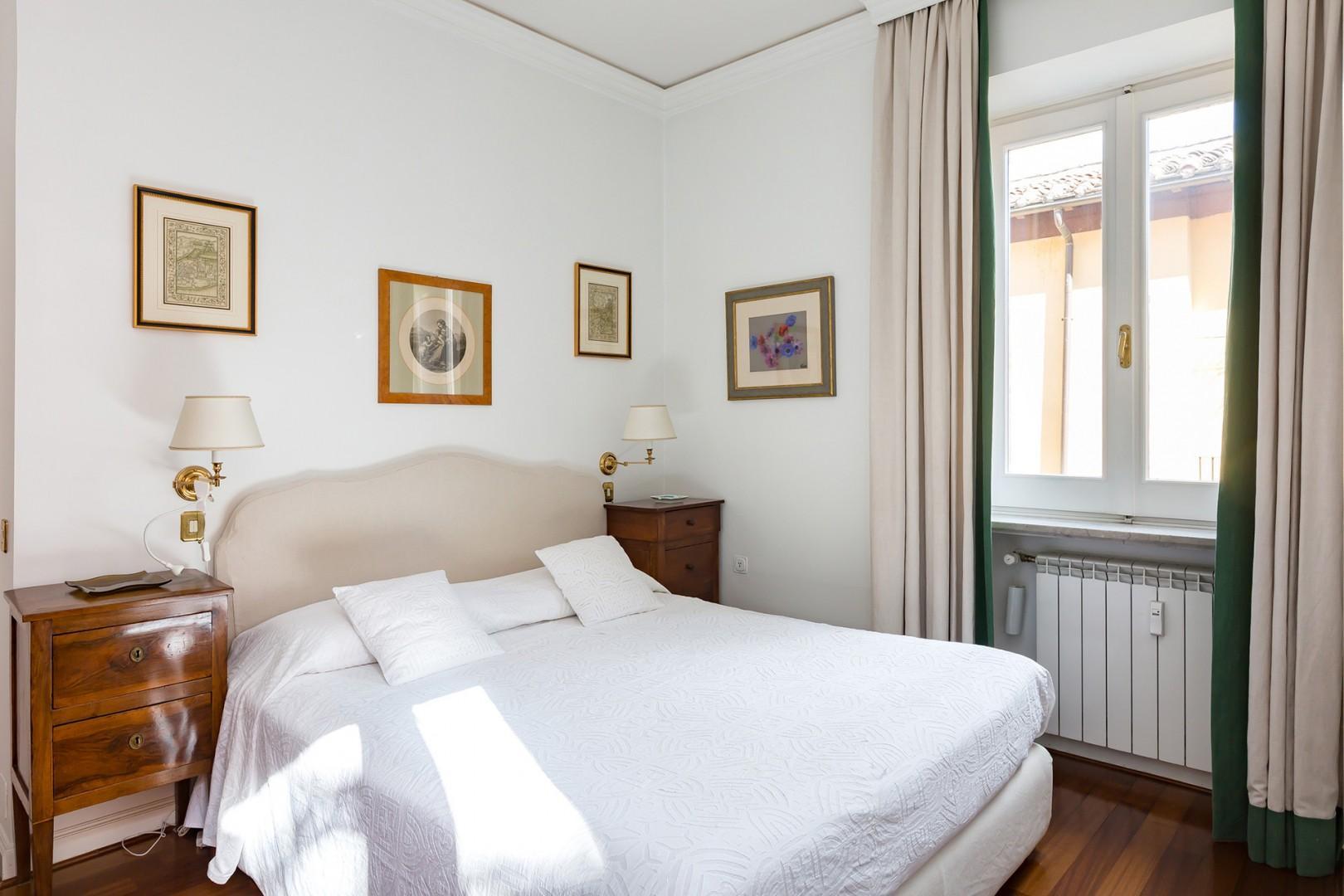 Bedroom 1 with beautiful antique nightstands.