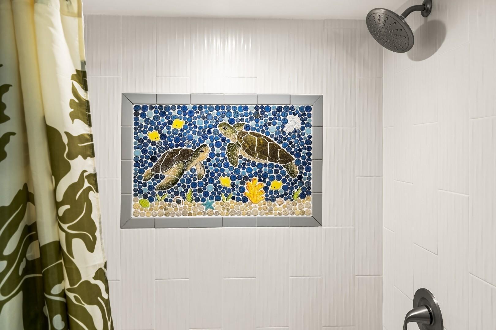Guest bathroom shower with mosaic tile design