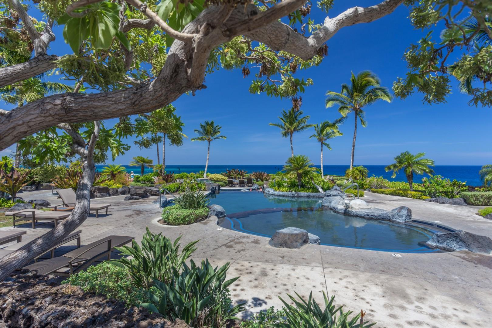 View of just a portion of the oceanfront multi-tiered lagoon style saltwater pool with plentiful loungers.