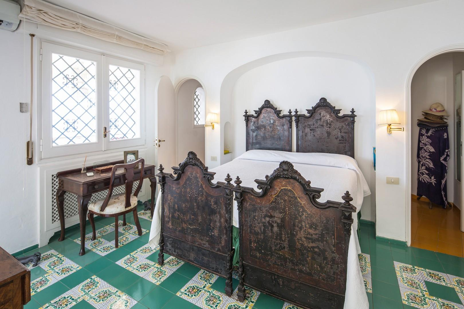In bedroom 1 traditional, antique bedsteads are used together to hold a large mattress.