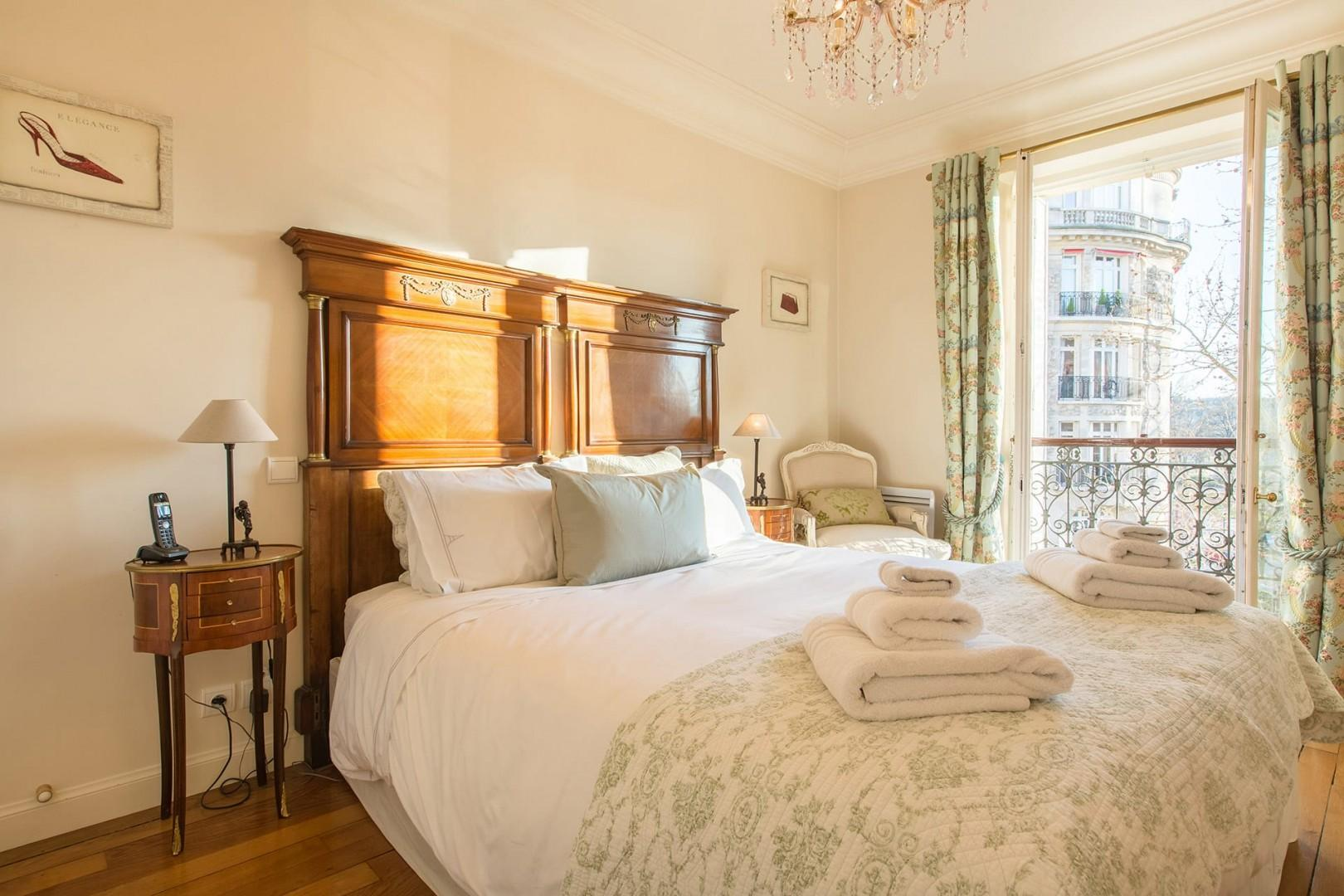 Wake up to the Paris sun in beautiful bedroom 1.