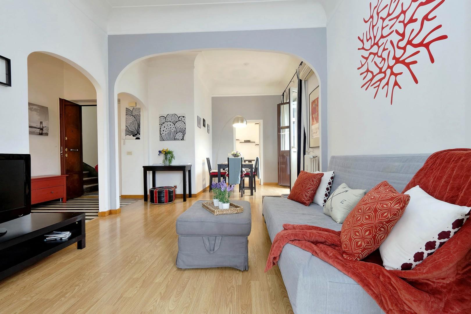 Two sets of archways frame the living room.