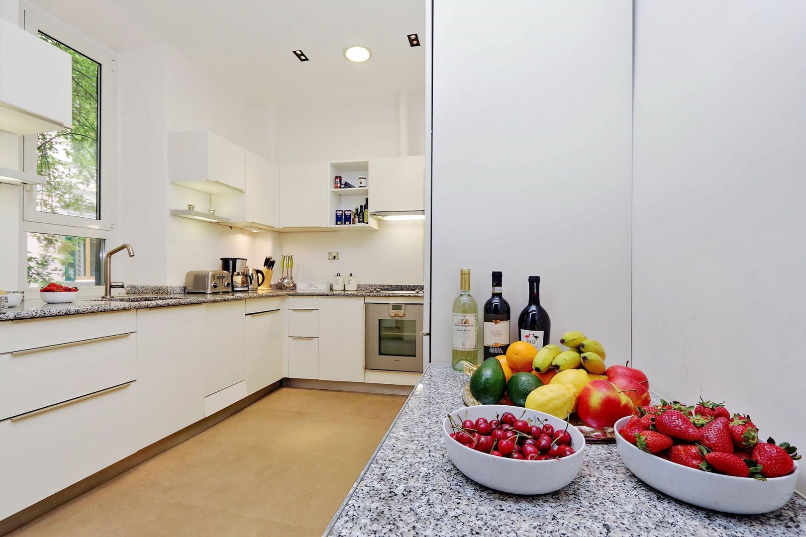Sleek, clean and bright kitchen.