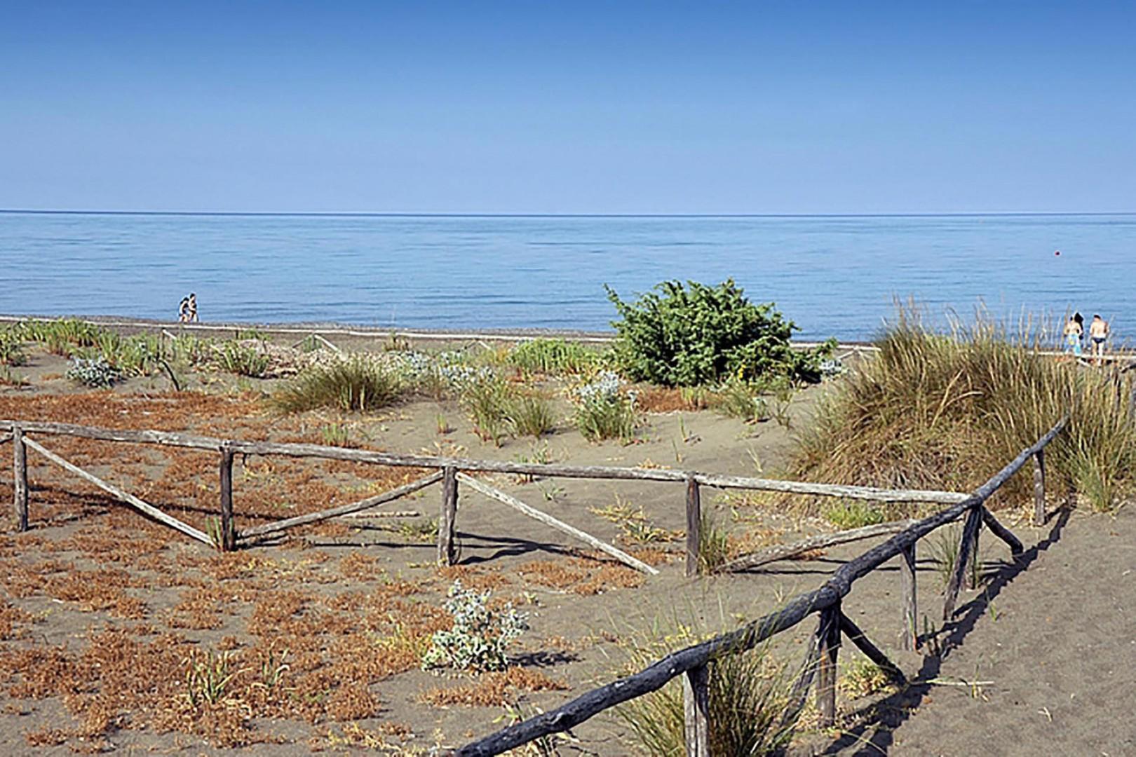 It is a 8 minute walk thru estates private pine grove to reach the beach.