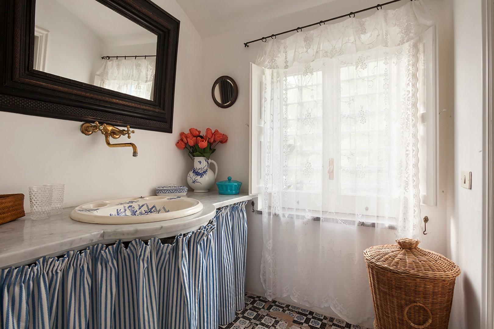 En suite bathroom to bedroom 5 has a large shower, sink, toilet and bidet.