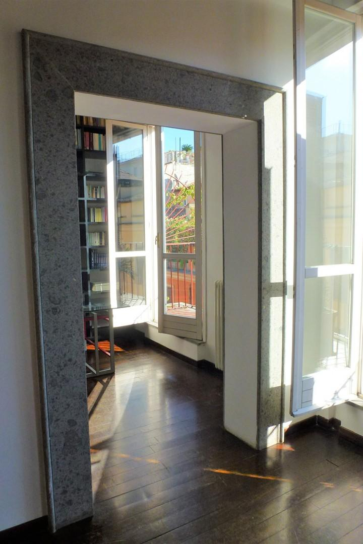 The study adjoins the living room area and has its own French doors out to the balcony.