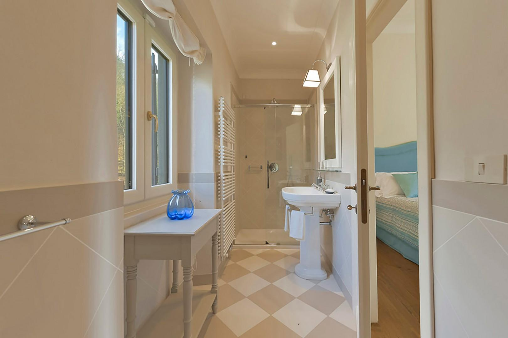 Bathroom 5 features heated towel racks and shower.