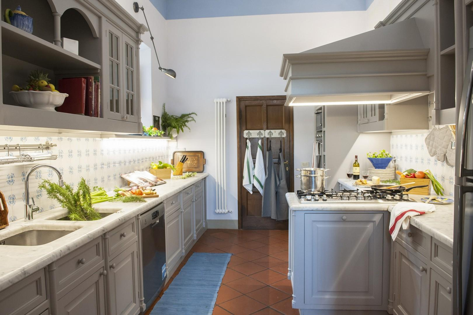 Top-of-the-line kitchen is fully appointed