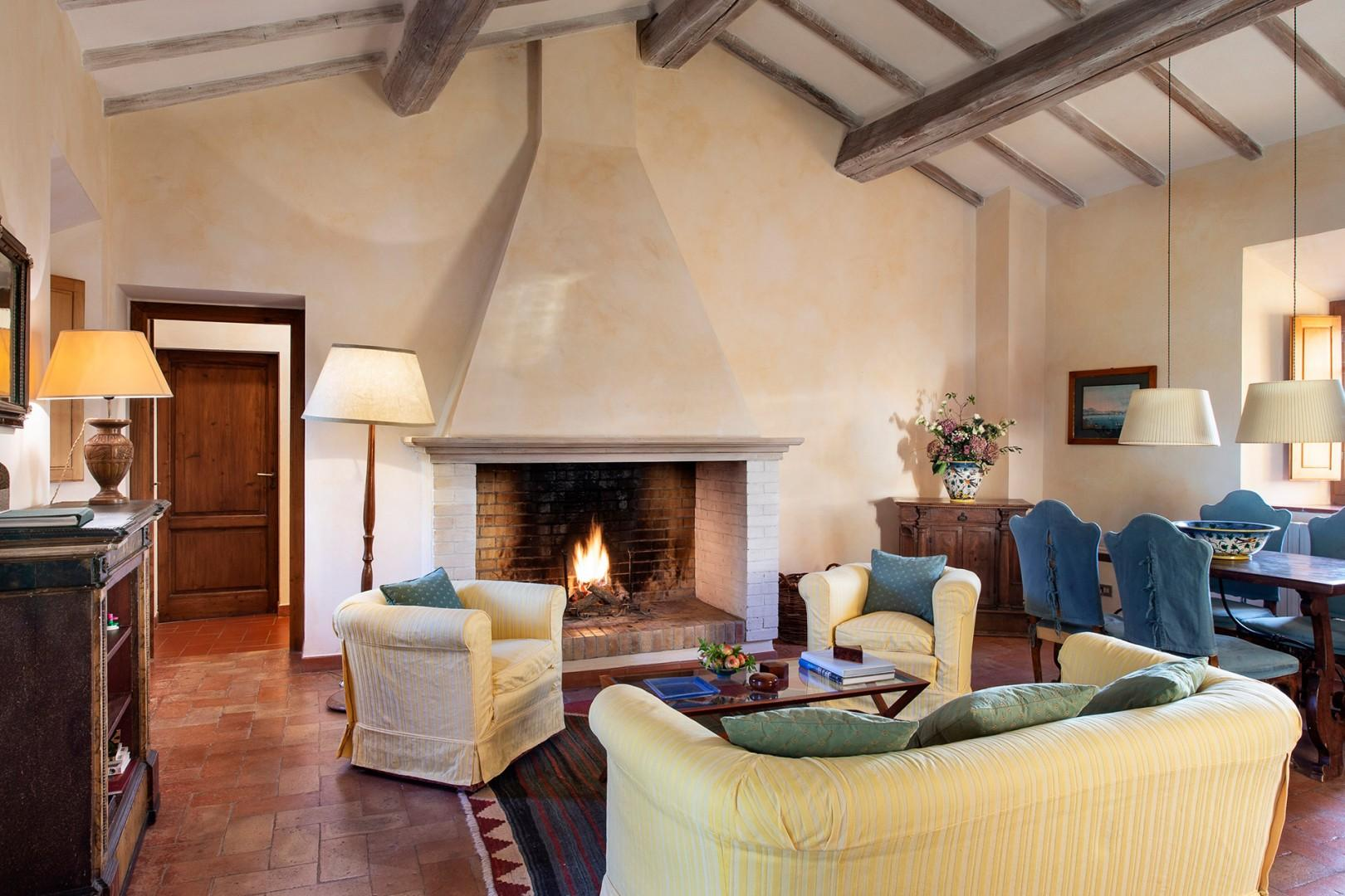 Tiglio apartment is a spacious luxury apartment for four. Living room has a cozy fireplace.