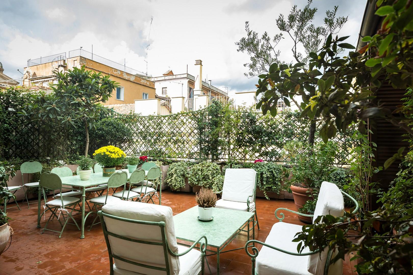The magnificent terrace is filled with mature shrubs and flowers