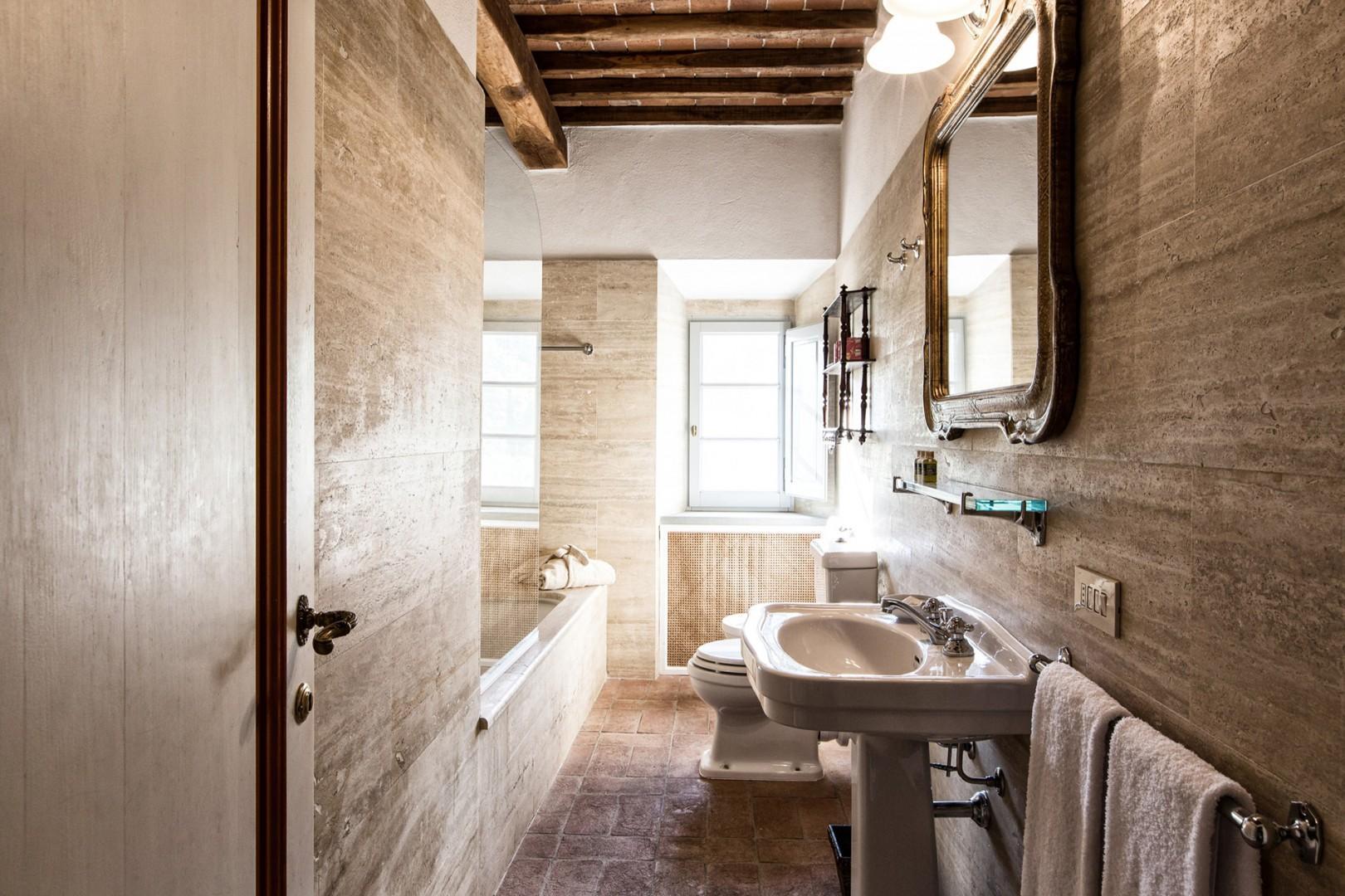 Rustic charm in each of the en suite bathrooms of this villa.