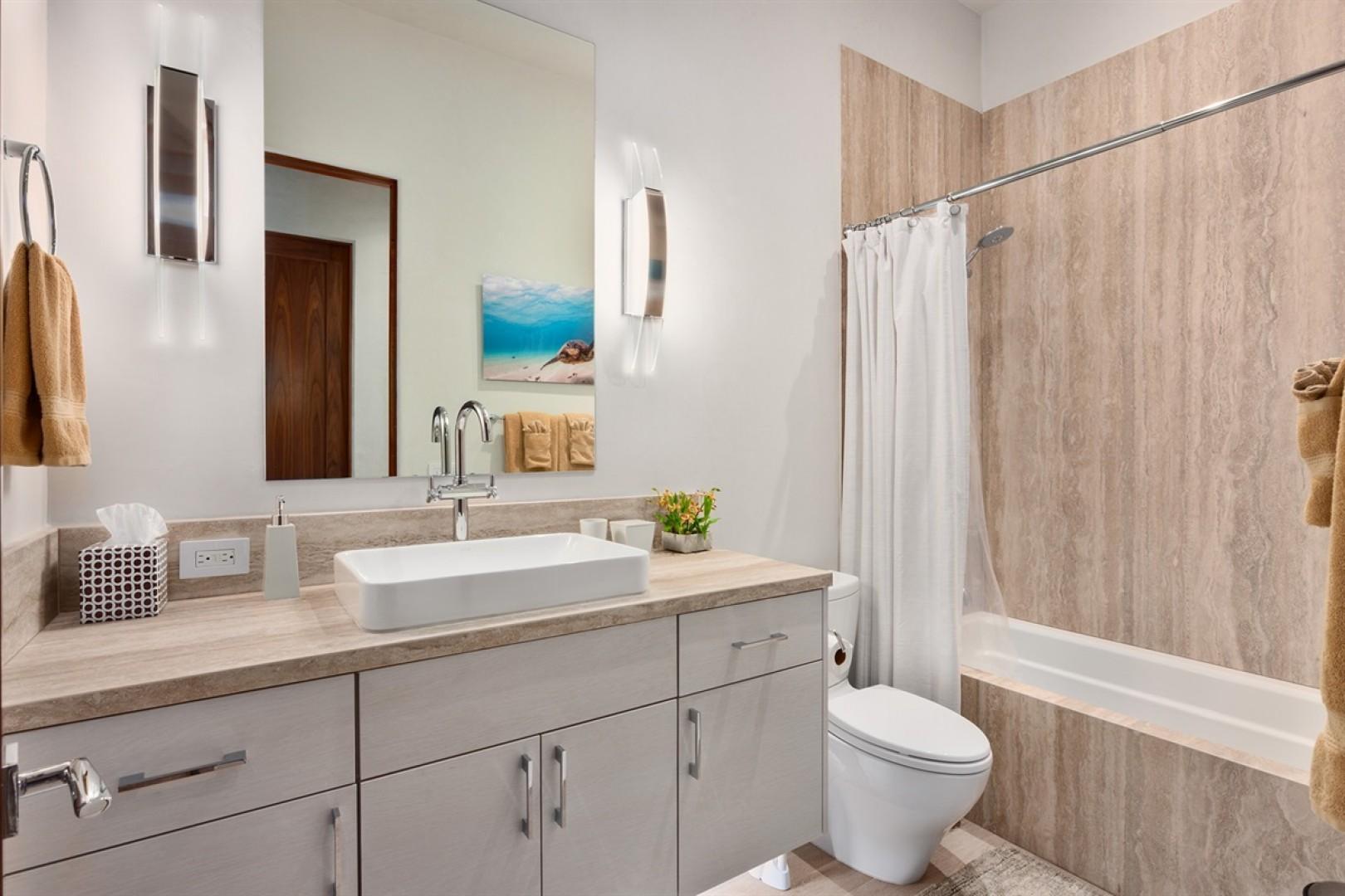 Adjacent full bath with tub/shower combo.