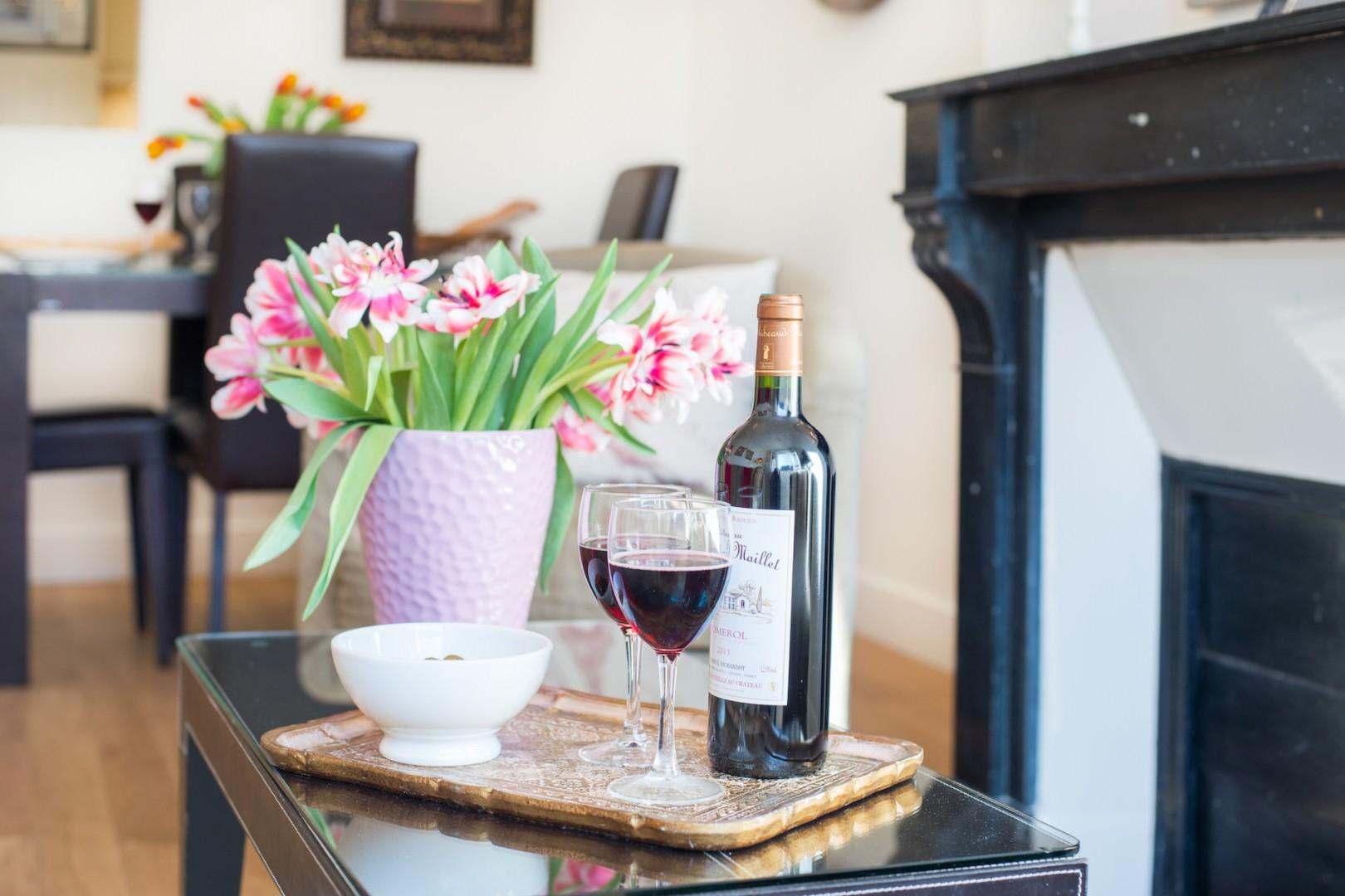 Relax with a glass of French wine by the fireplace.