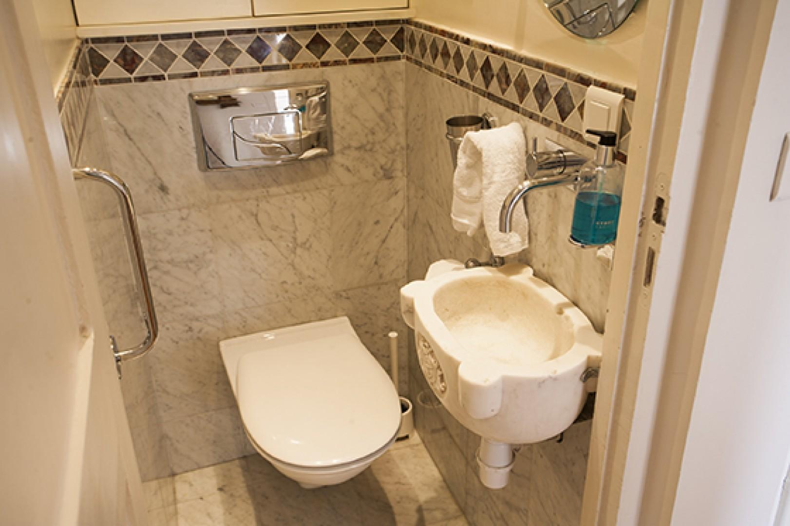 There's a half bath with toilet for extra 'getting ready' room.