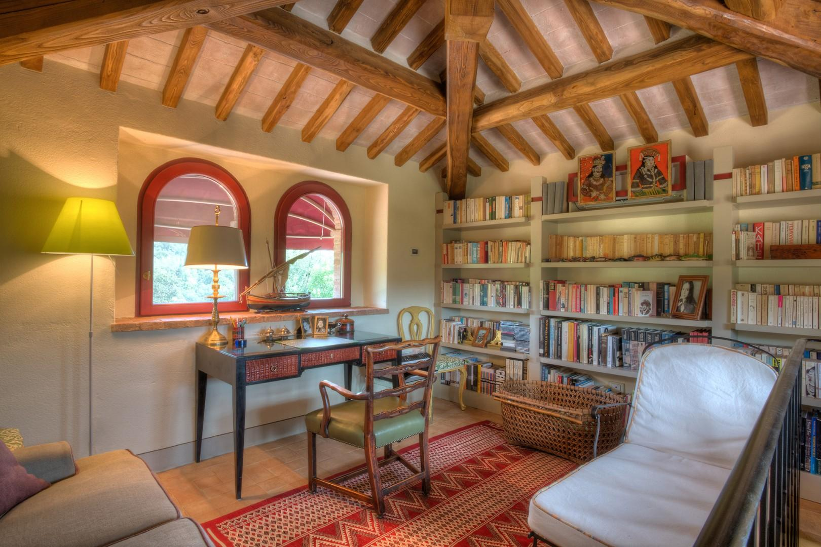 Top floor study under the eaves has lovely views through the two arched windows.