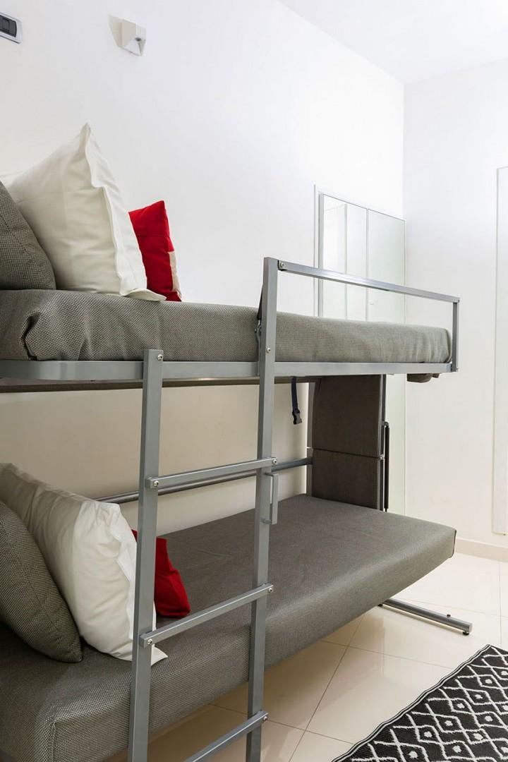 Voila! Through the marvels of Italian furniture design the bed can be turned into a bunk bed.
