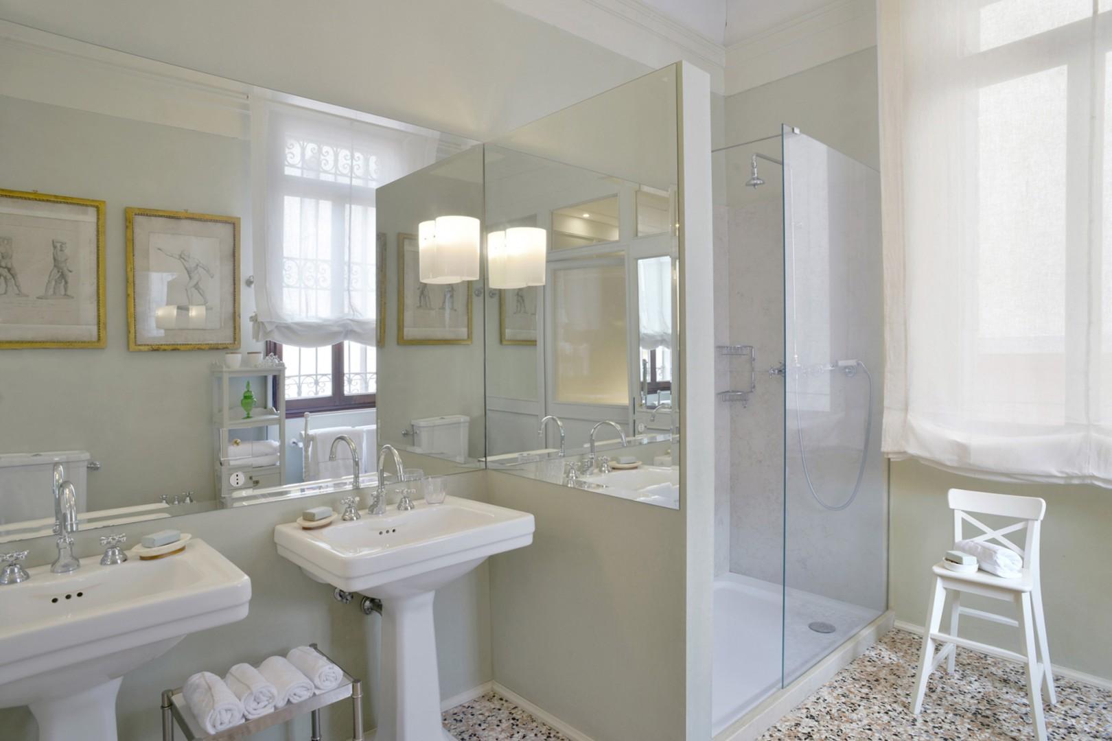 Bathroom 1 has a large shower.