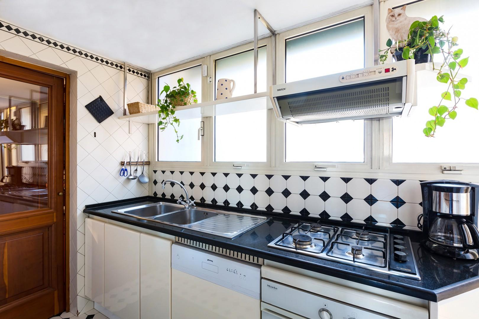 Kitchen is bright and will appointed. It is compact, typical for Italian homes.