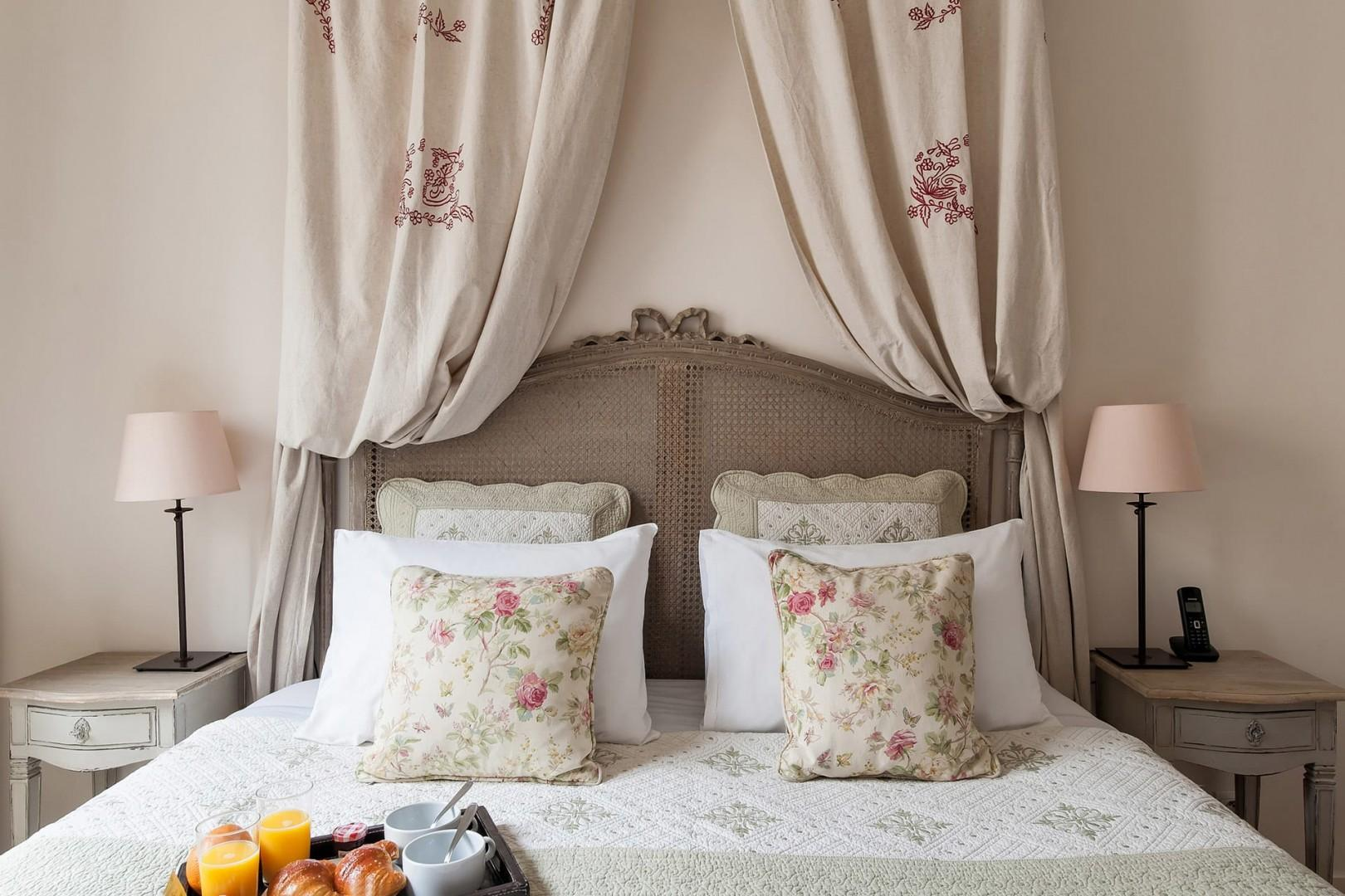 Enjoy reading in the comfortable bed with two bedside lamps.