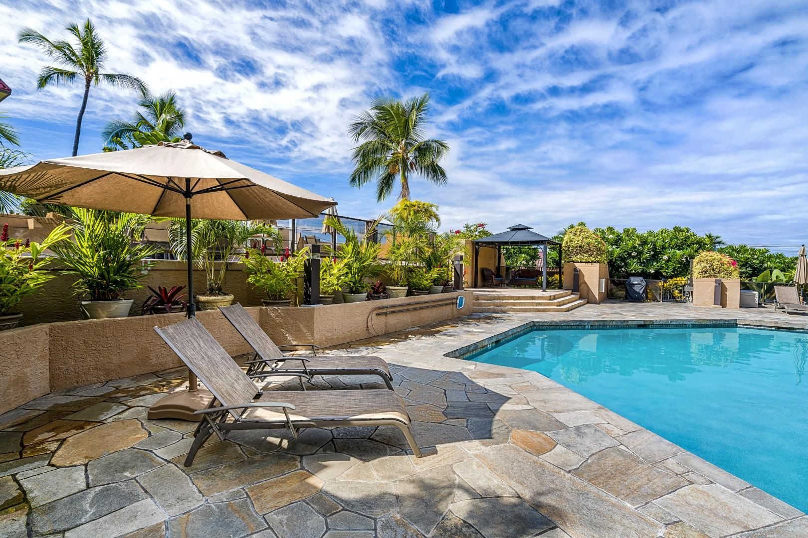 Lounge pool side to work on your tan!