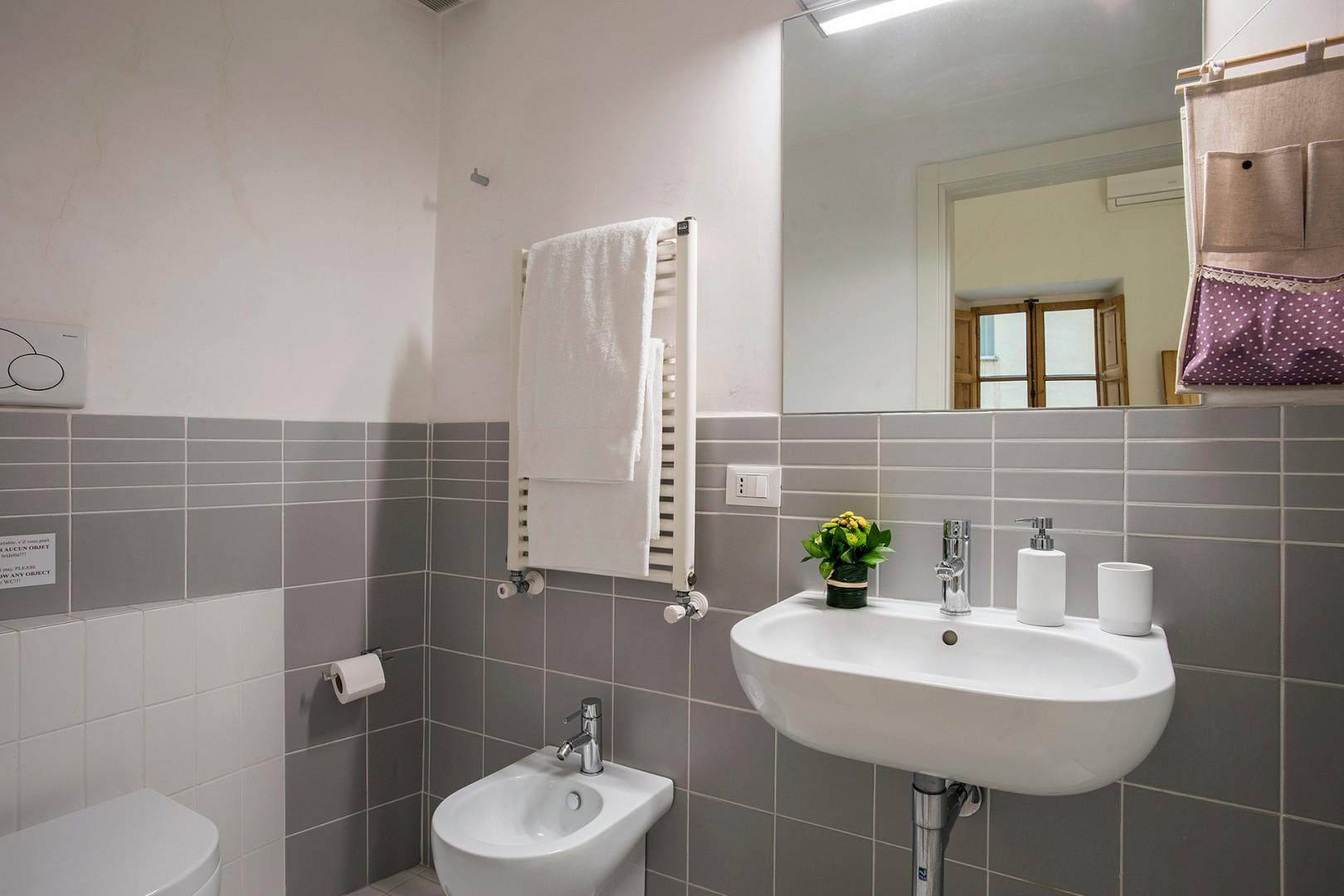 Bathroom 1 is en suite to bedroom 1 with shower, sink, toilet, and bidet.