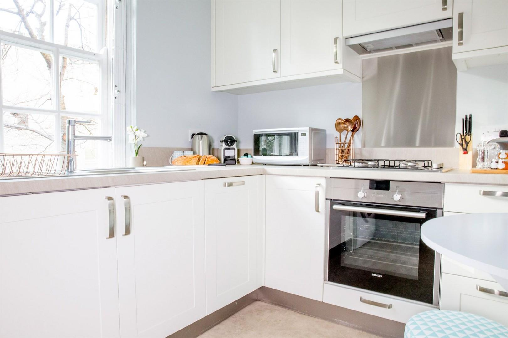 Kitchen is fully equipped with everything you need to cook at home
