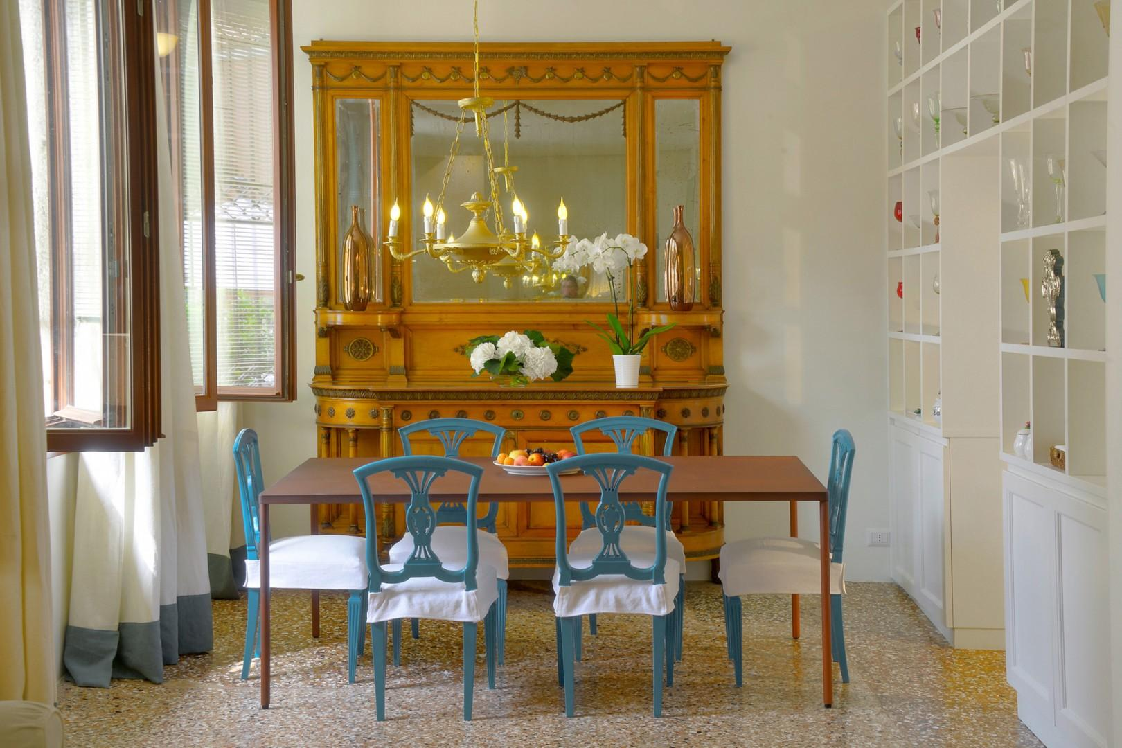 The dining room adjoins the living room with a gorgeous antique sideboard.