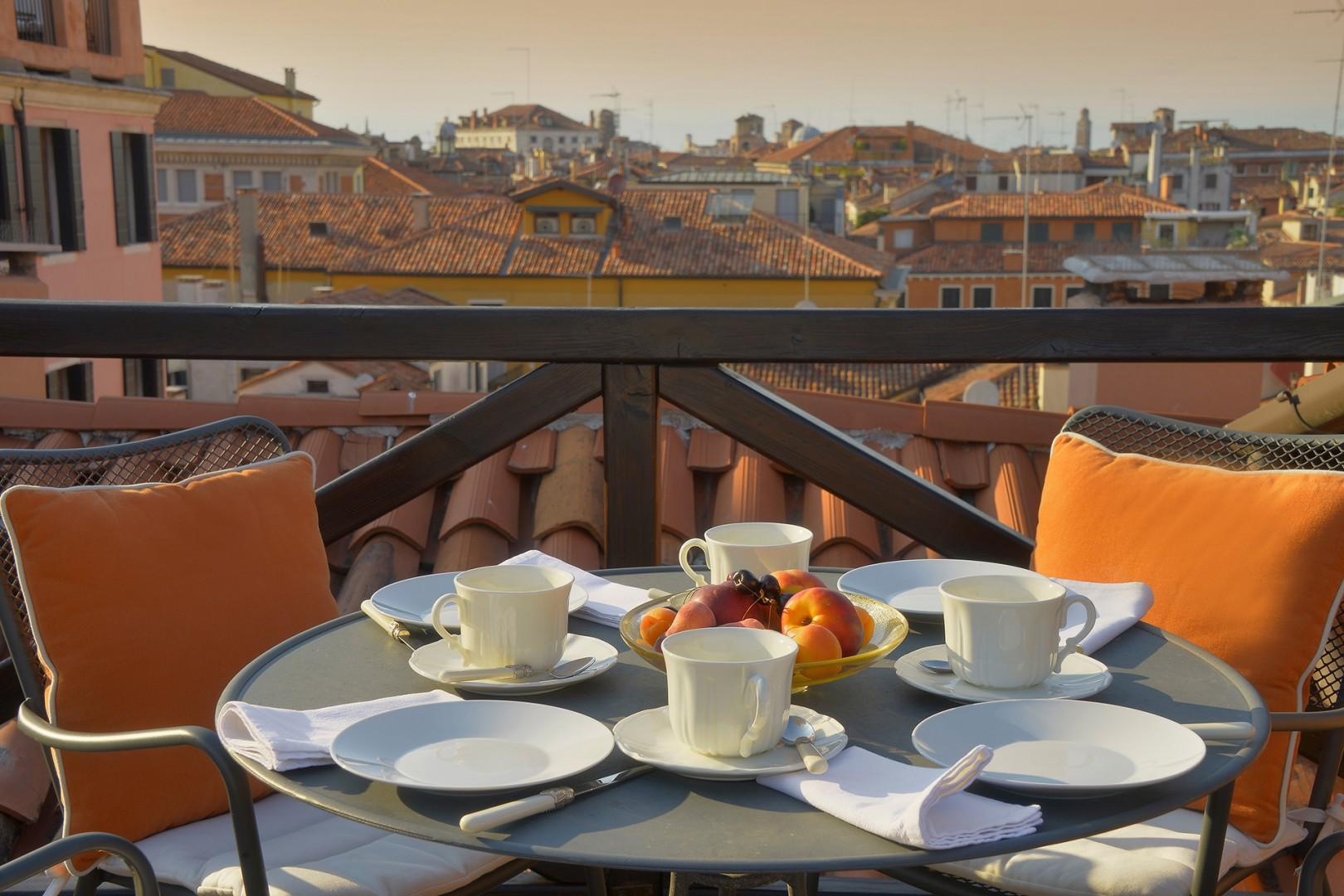 The private terrace of the Cassia apartment also has a dining table for four.