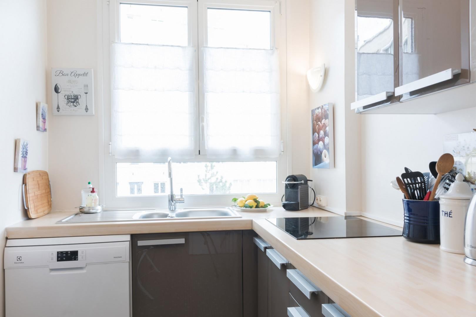 The large window above the sink lets in lots of light.