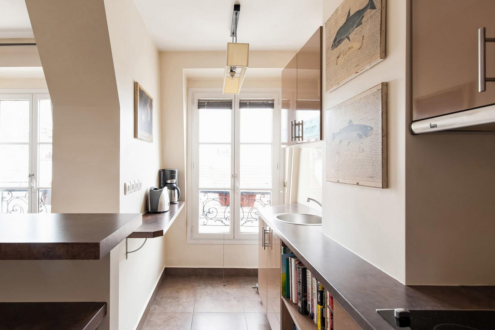 The modern kitchen is extremely spacious and sunny.