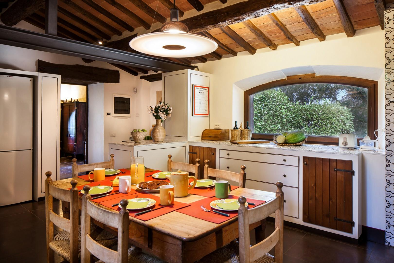 Well appointed eat-in kitchen is light filled and large.
