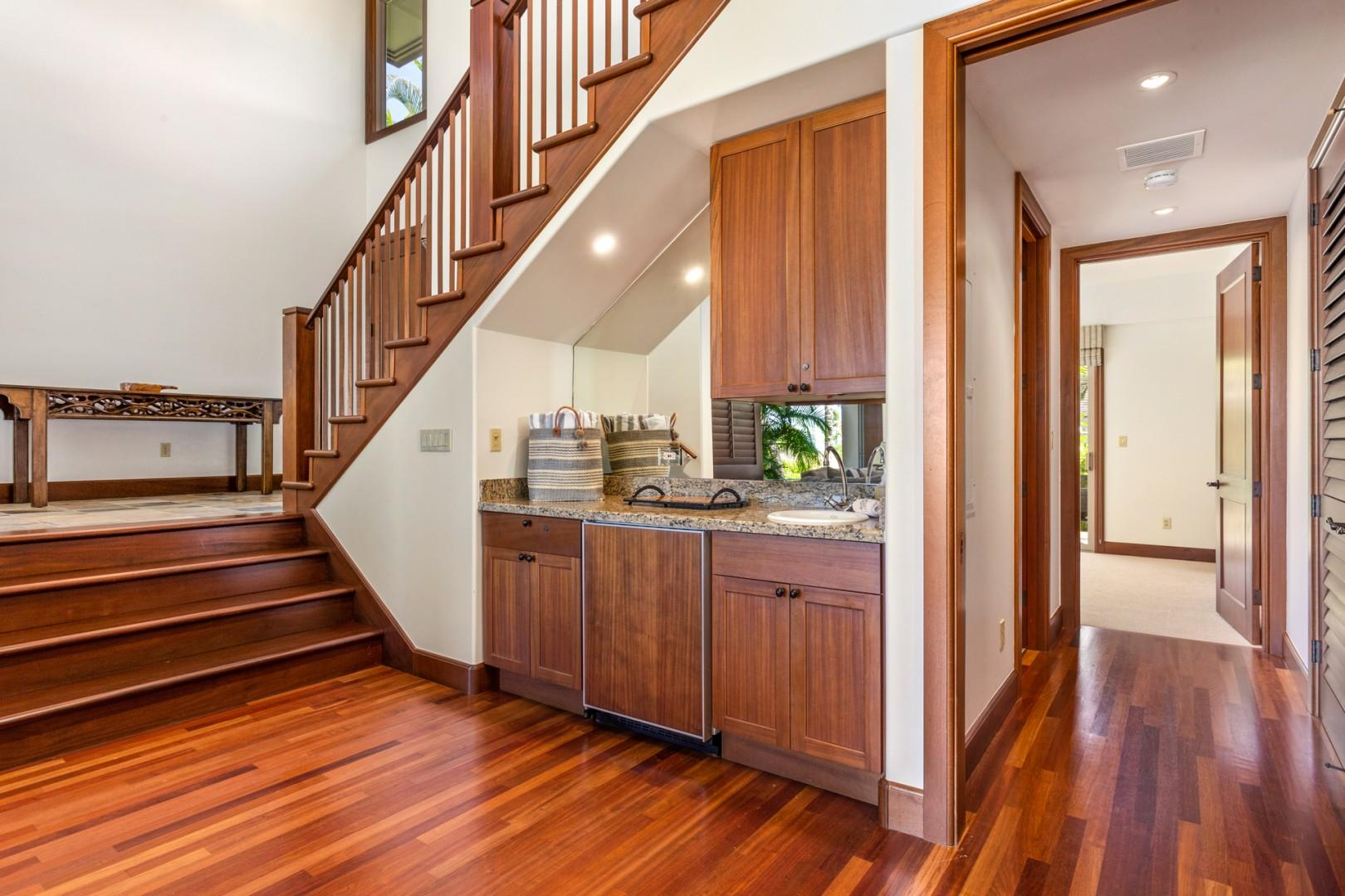 """Lower level staircase leading to downstairs """"bonus living room""""."""