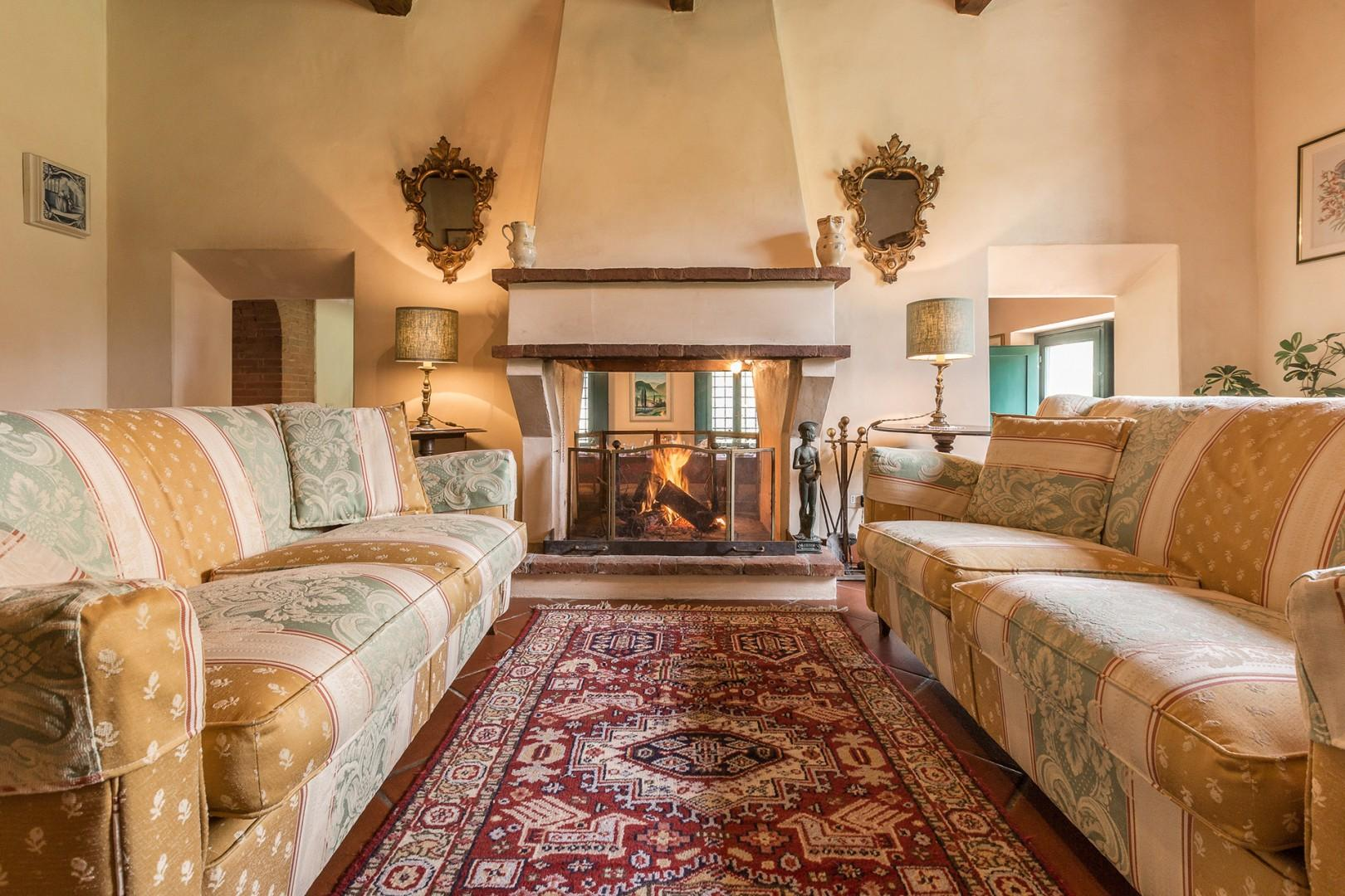 A charming feature is the fireplace that lies between the lounge and the large dining room.