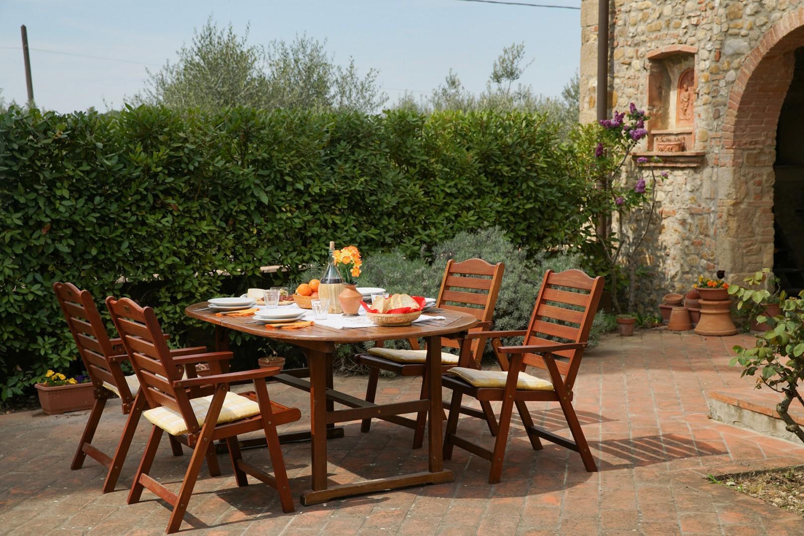 Enjoy meals al fresco on the sunny terrace at Casa San Vito.