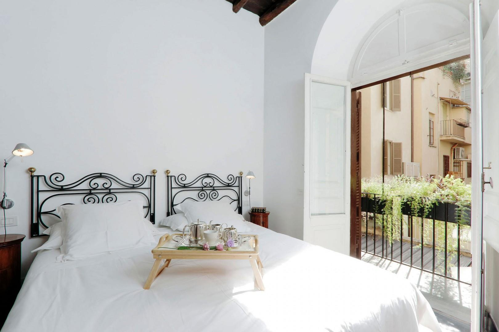 Lovely bedroom 3 with a private balcony.