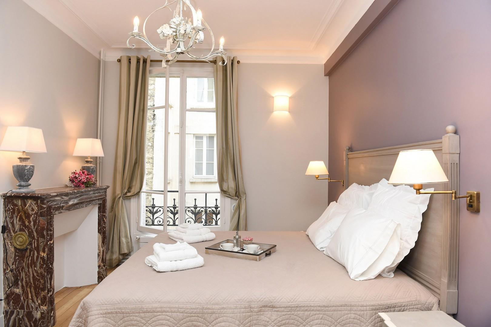 Make yourself at home in the beautiful bedroom 1 with a luxurious bed.
