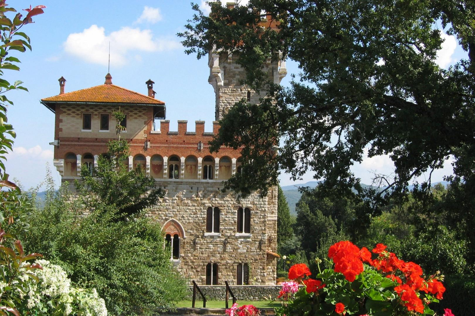 """A perfect medieval castle overlooks the hamlet """"Borgo"""" that has been turned into a vacation village"""