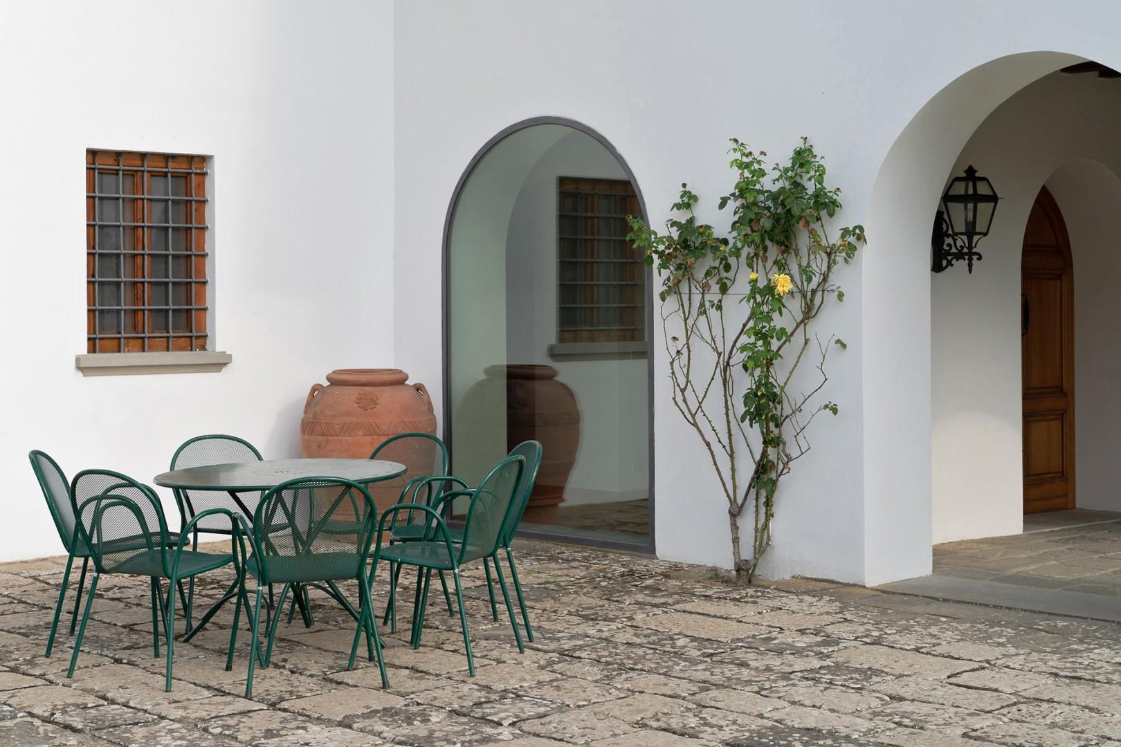 Enjoy meals al fresco at this outdoor seating area on the patio.