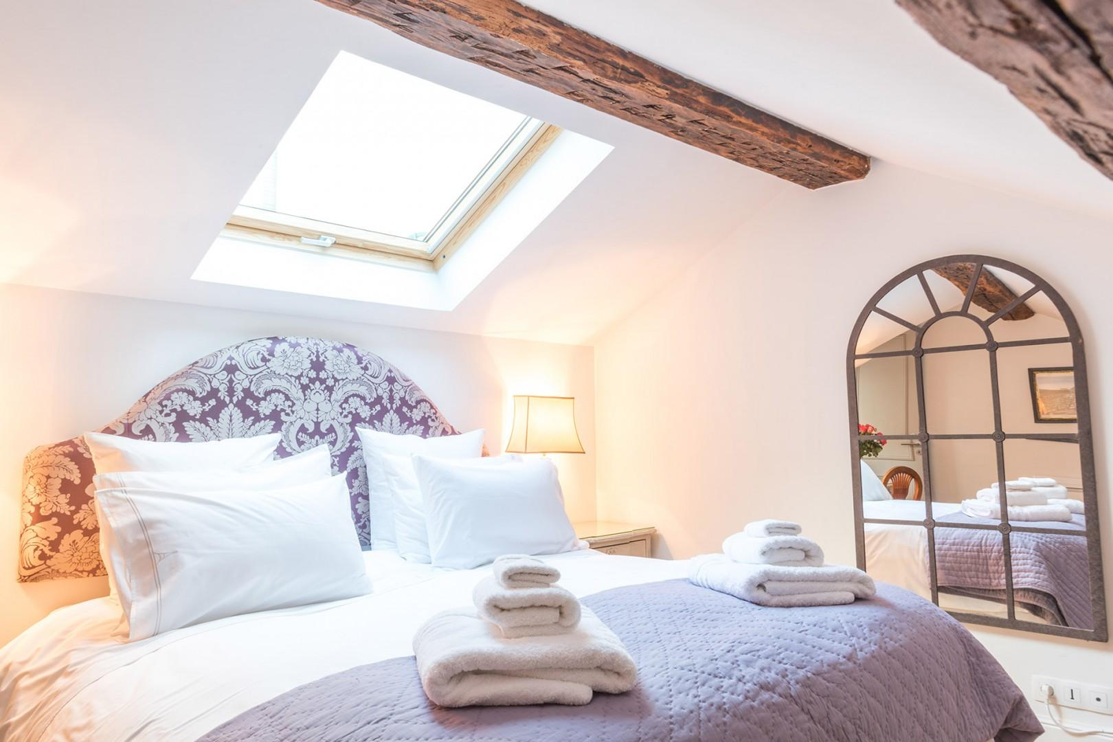 The skylight in the bedroom lets in lots of natural light.
