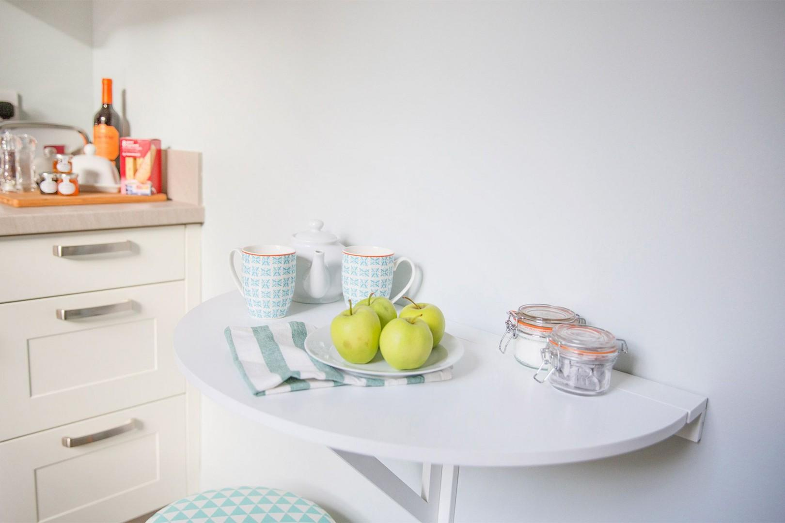 Small fold out table is perfect for quick breakfasts