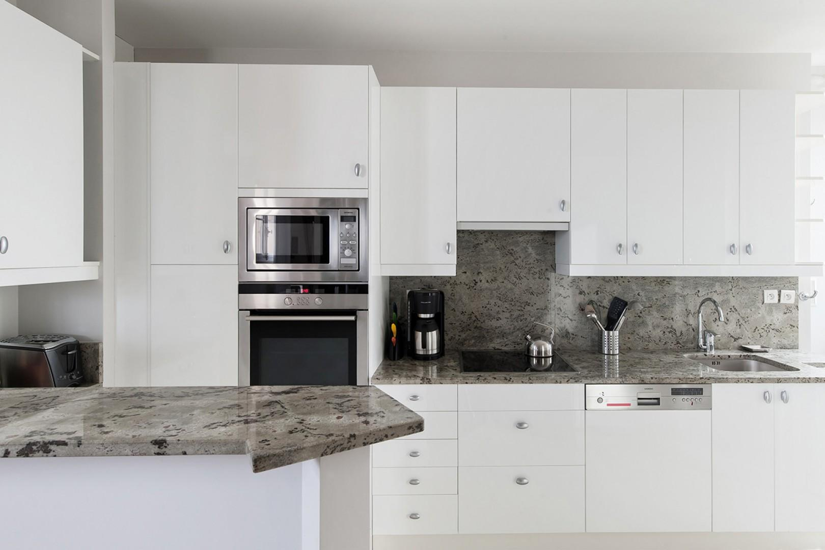 Enjoy the fully equipped kitchen with modern appliances.