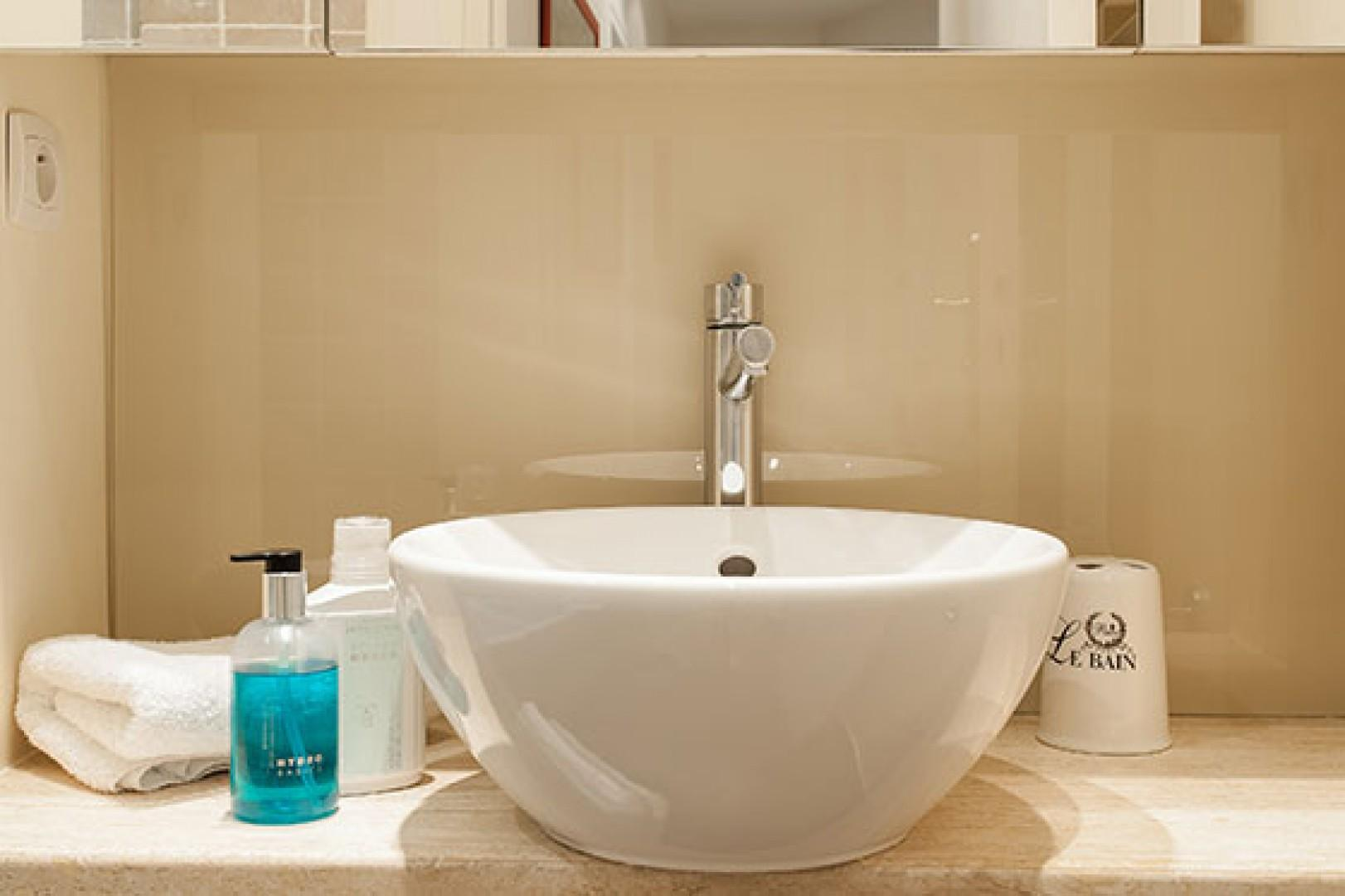 Stylish finishes are found throughout the bathroom.