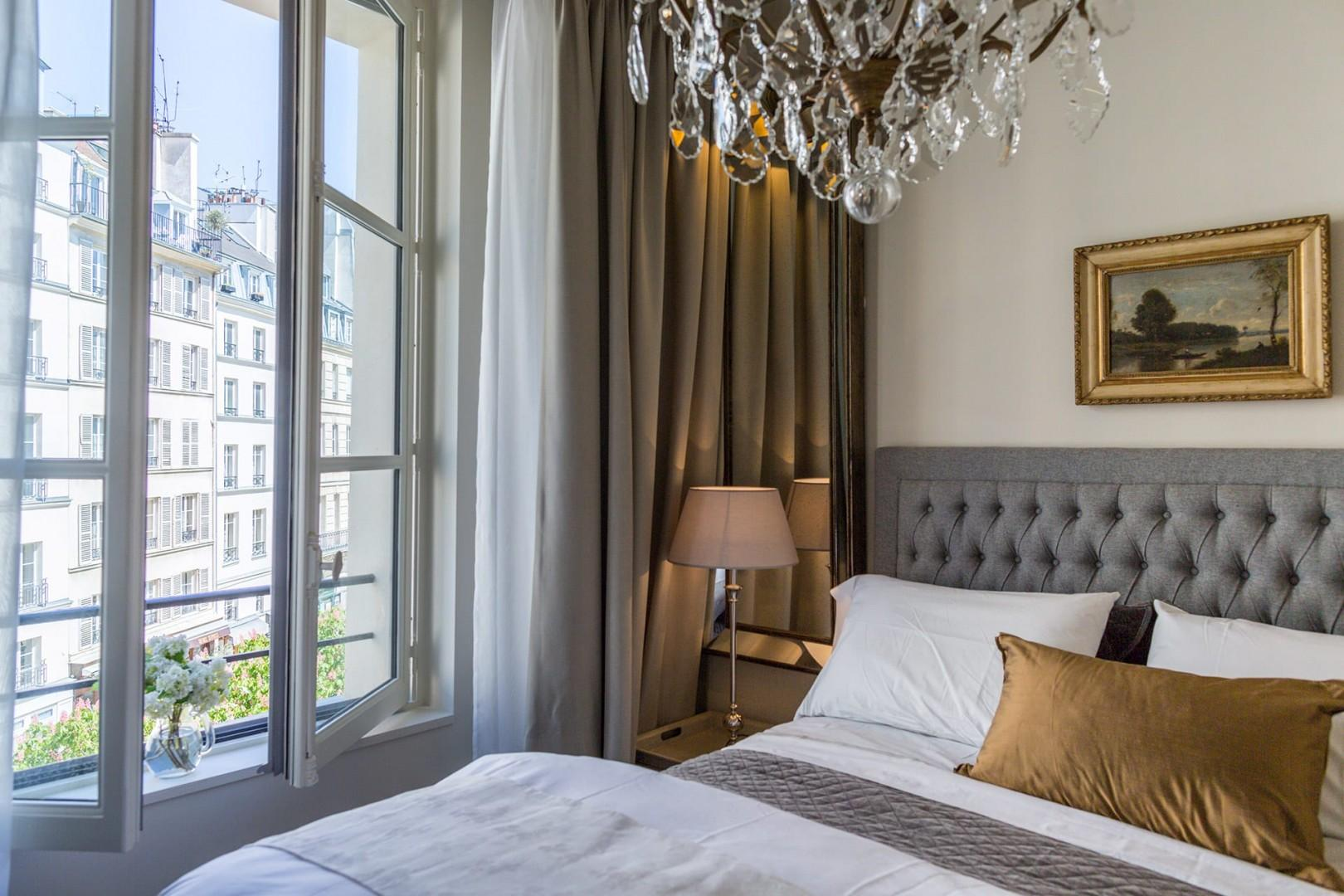 Wake up to the pretty views of Place Dauphine from the bedroom window.