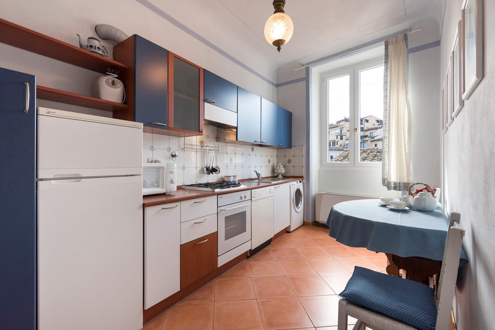 Bright and well equipped kitchen with table for two.