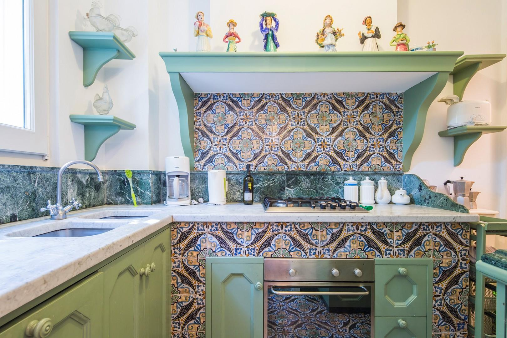 Beautiful tilework in fully equipped kitchen.