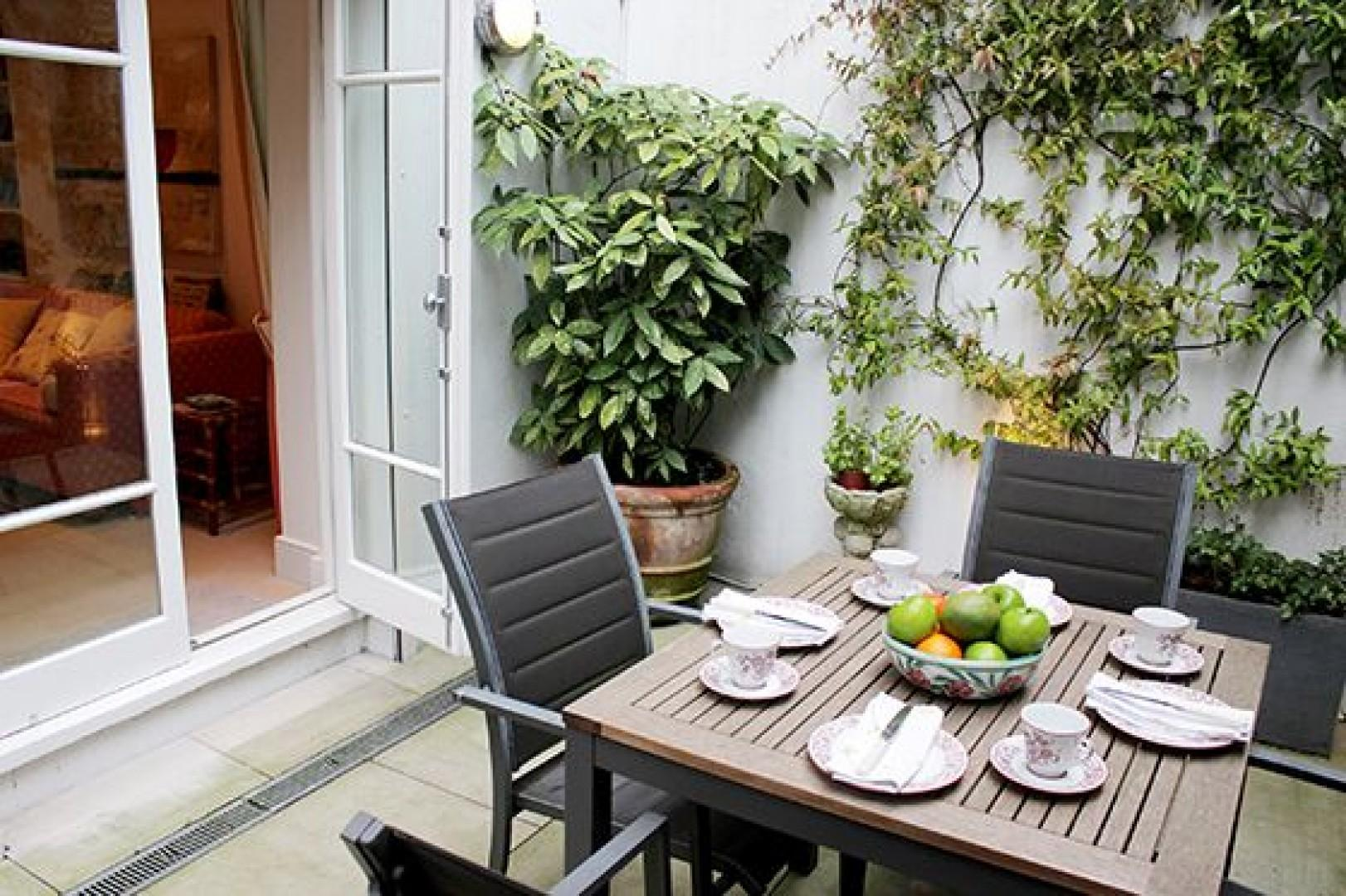 Step out onto the private patio garden just off the den