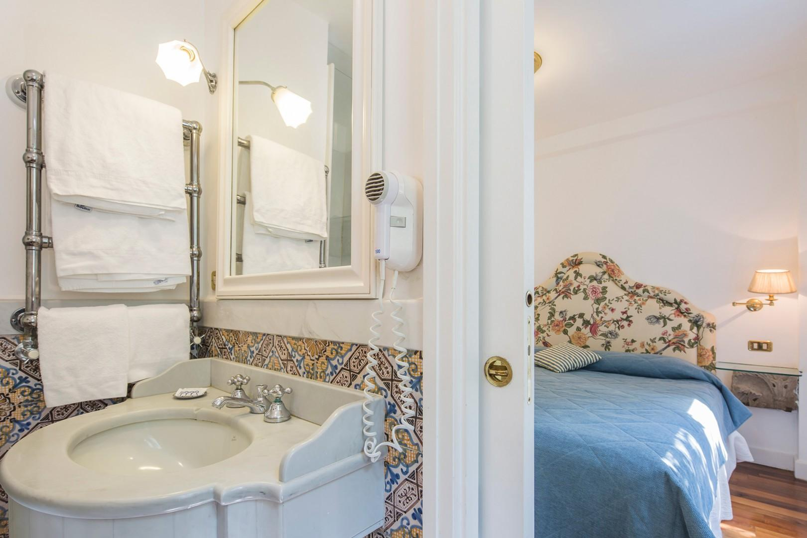 En suite bathroom to bedroom 2 has shower, sink, toilet and bidet.