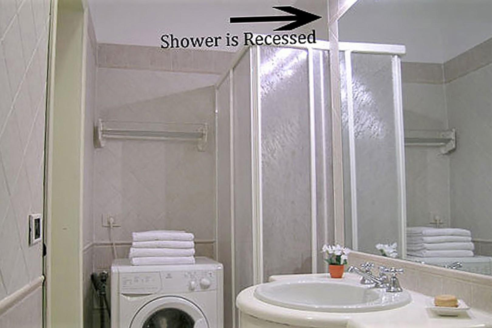 Washing machine and shower. Please note the photo is deceiving, the shower is recessed.