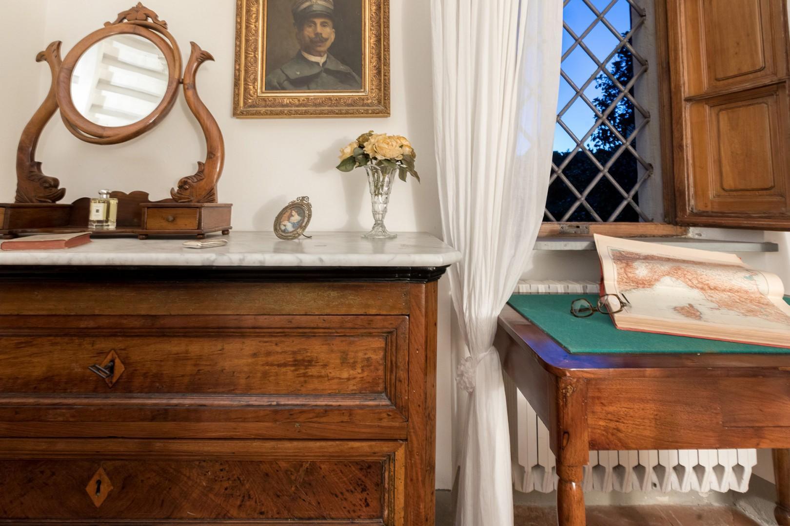 The antique bureau has a pretty mirror.